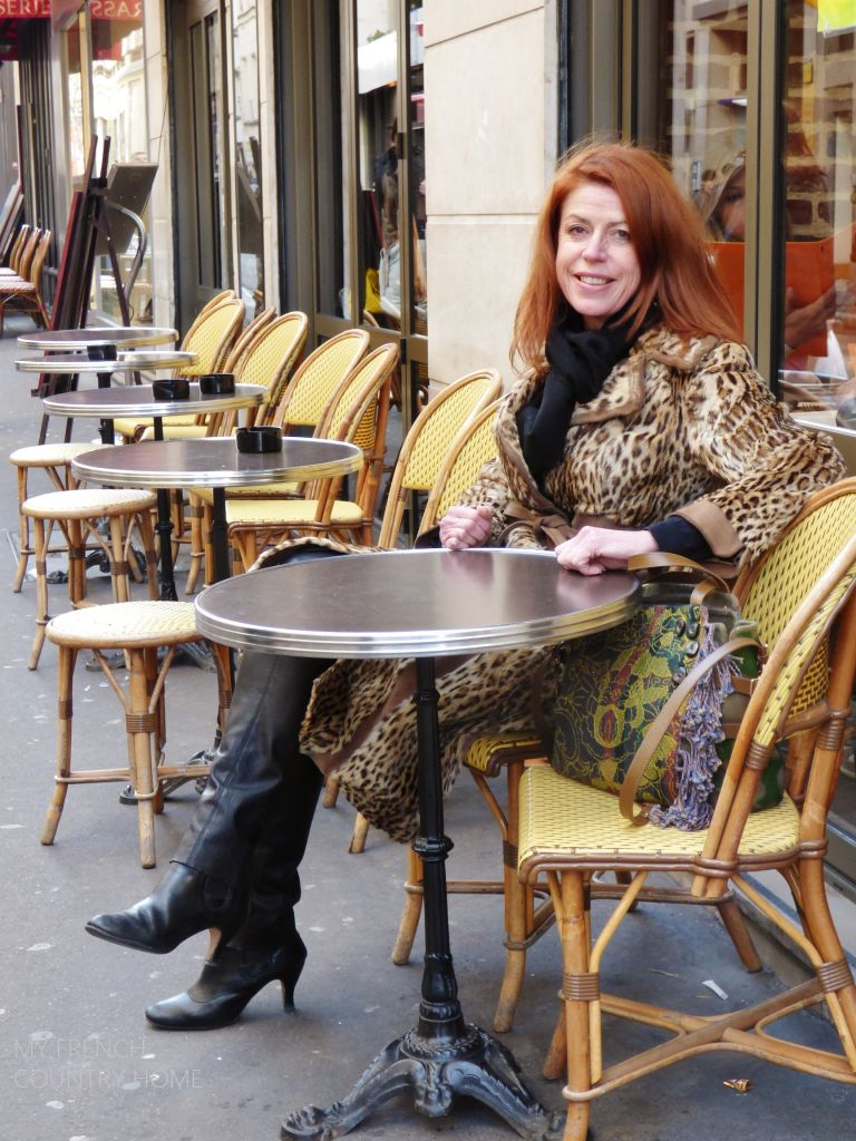 SYLIVE ROBAGLIA SEATED AT A CAFE IN PARIS