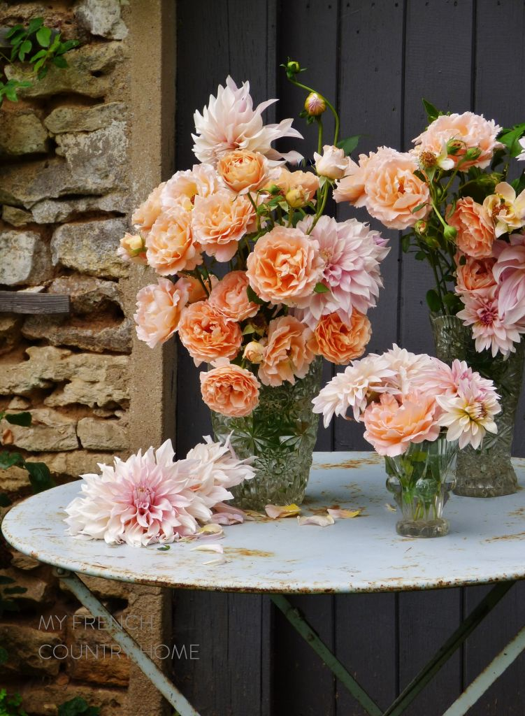 orange roses and pink dahlias in vase